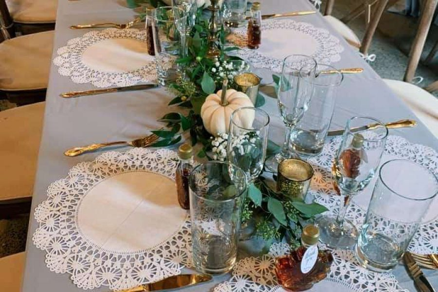 greenery and pumpkins along center of table