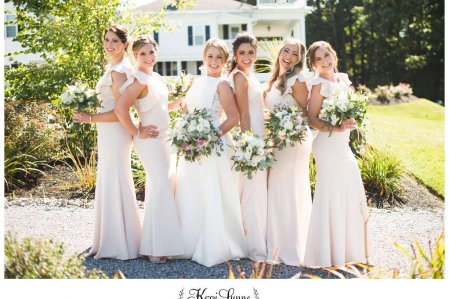 bride and bridesmaids with wedding flowers
