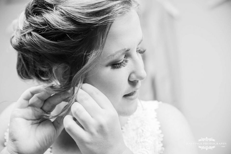 bride getting ready in black and white photography