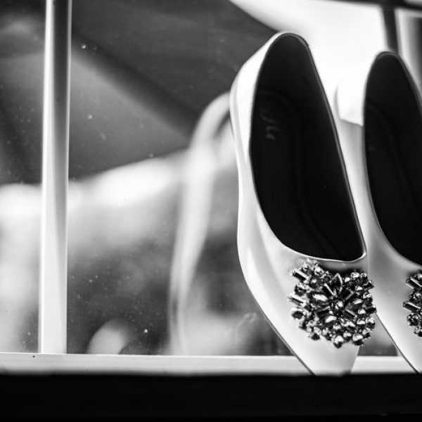 bride's shoes in black and white