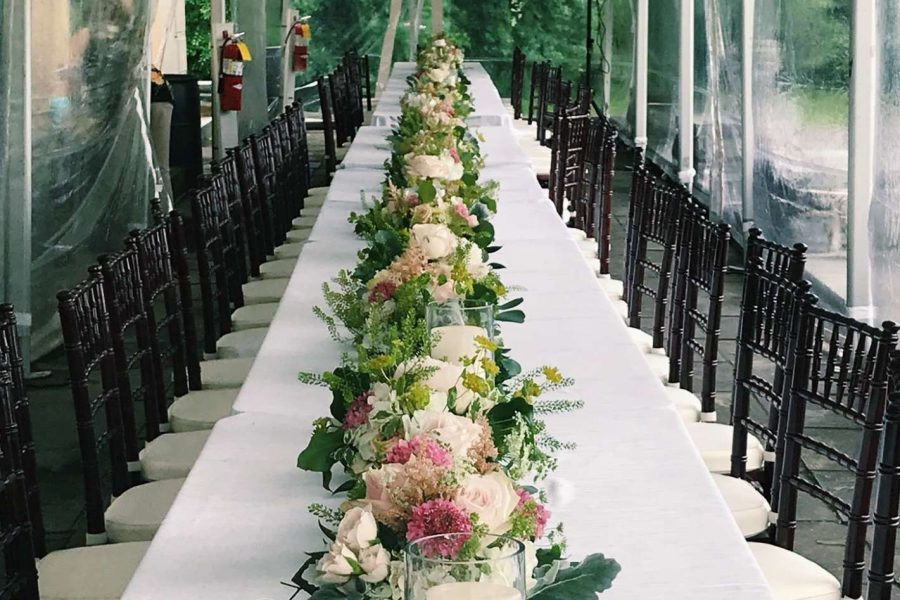 long table with flowers and candles