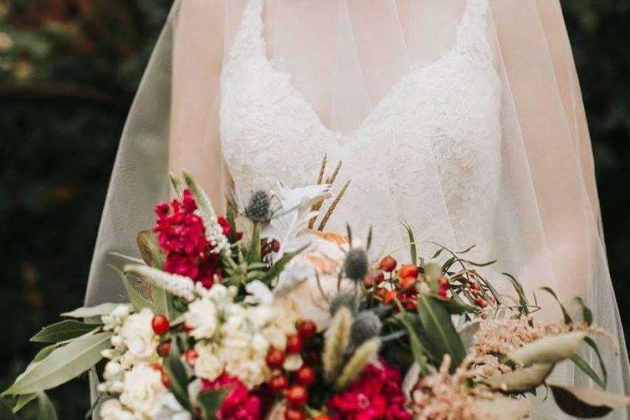 bride with whimsical wedding bouquet flowers