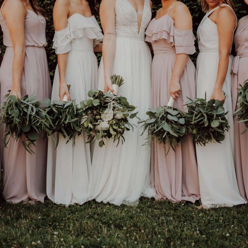 dresses bride bridesmaids posing