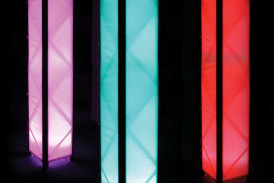 three light pillars in red, blue, purple