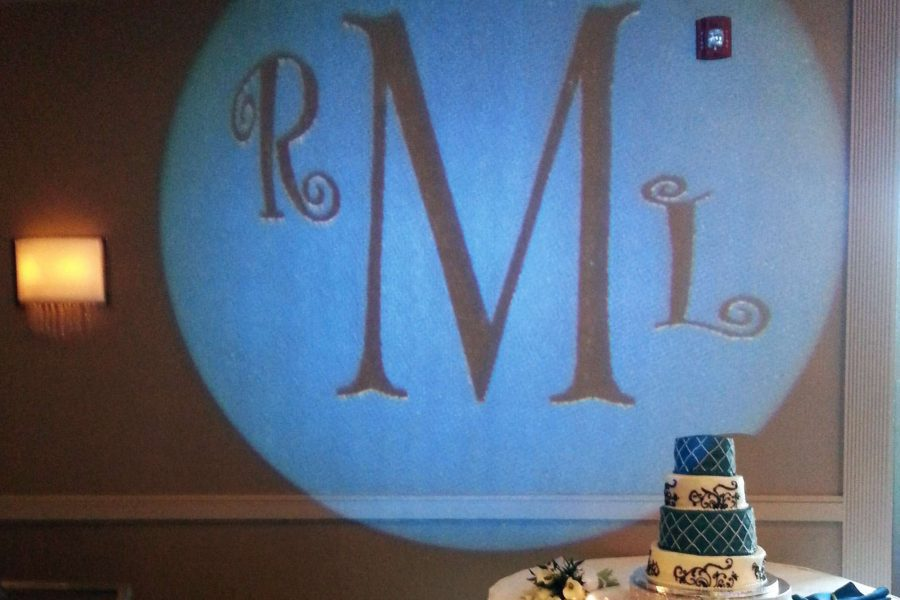 initials projected on a wall at a wedding