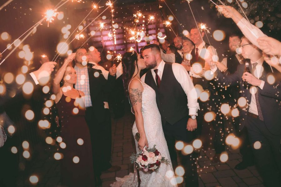sparklers light up the kissing couple