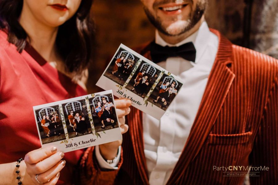 wedding guests hold photo prints