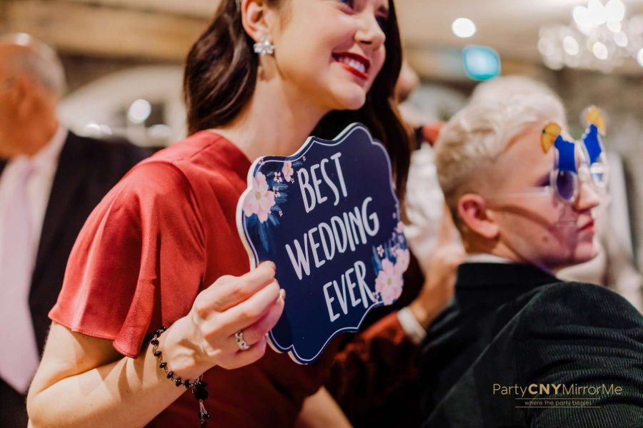 wedding guest smiles at photo mirror