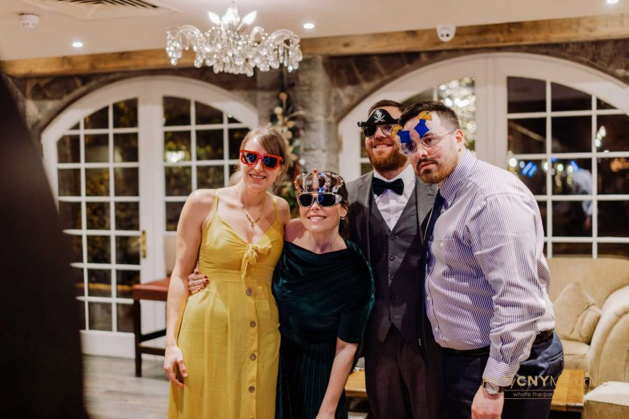 wedding guests wear props and pose
