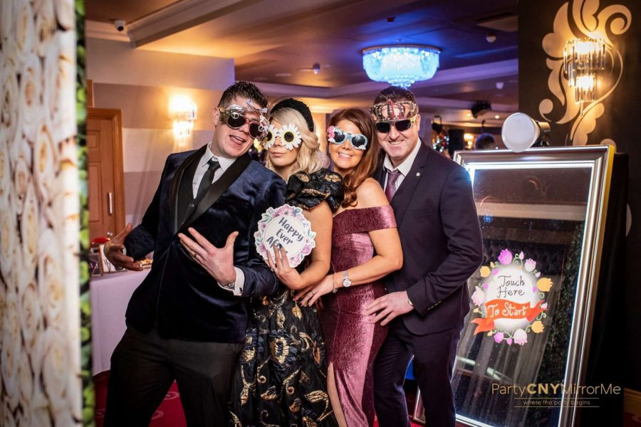 mirror photo booth with wedding guests