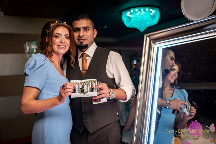 mirror photo booth print out held by couple