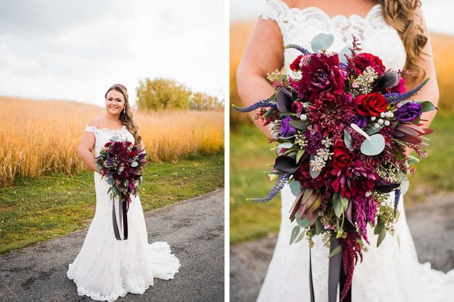 Bride holds big bouquet of red and purple flowers