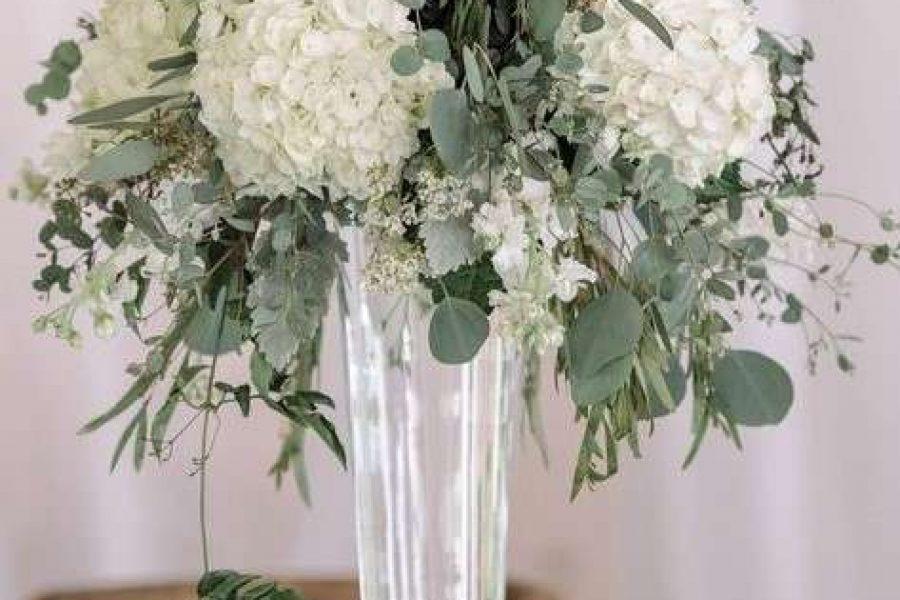 wedding centerpiece designed with white flowers