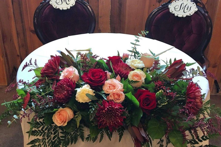 flowers decorate sweetheart table at wedding