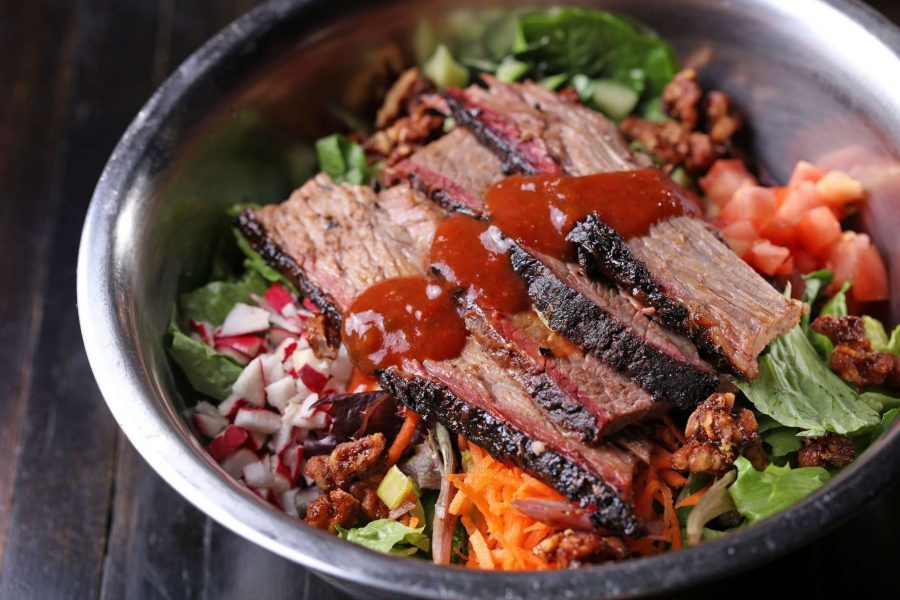meat on salad with BBQ sauce