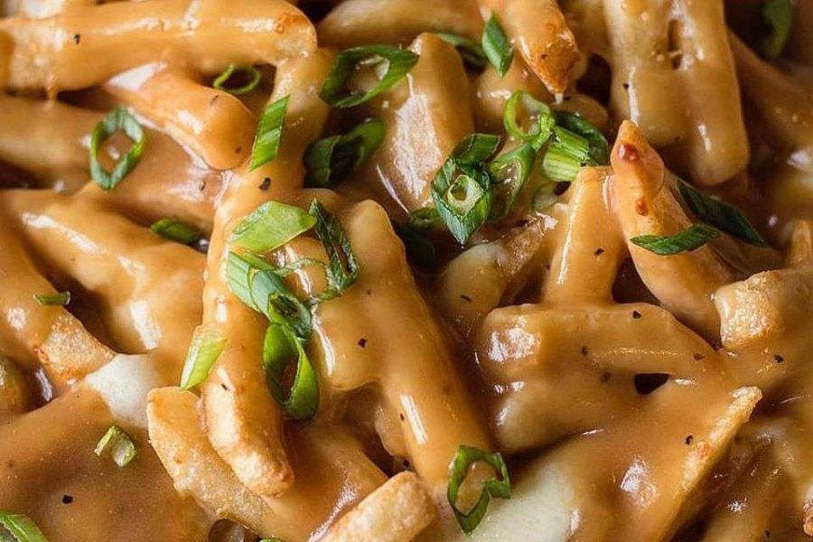 French fries with sauce and greens